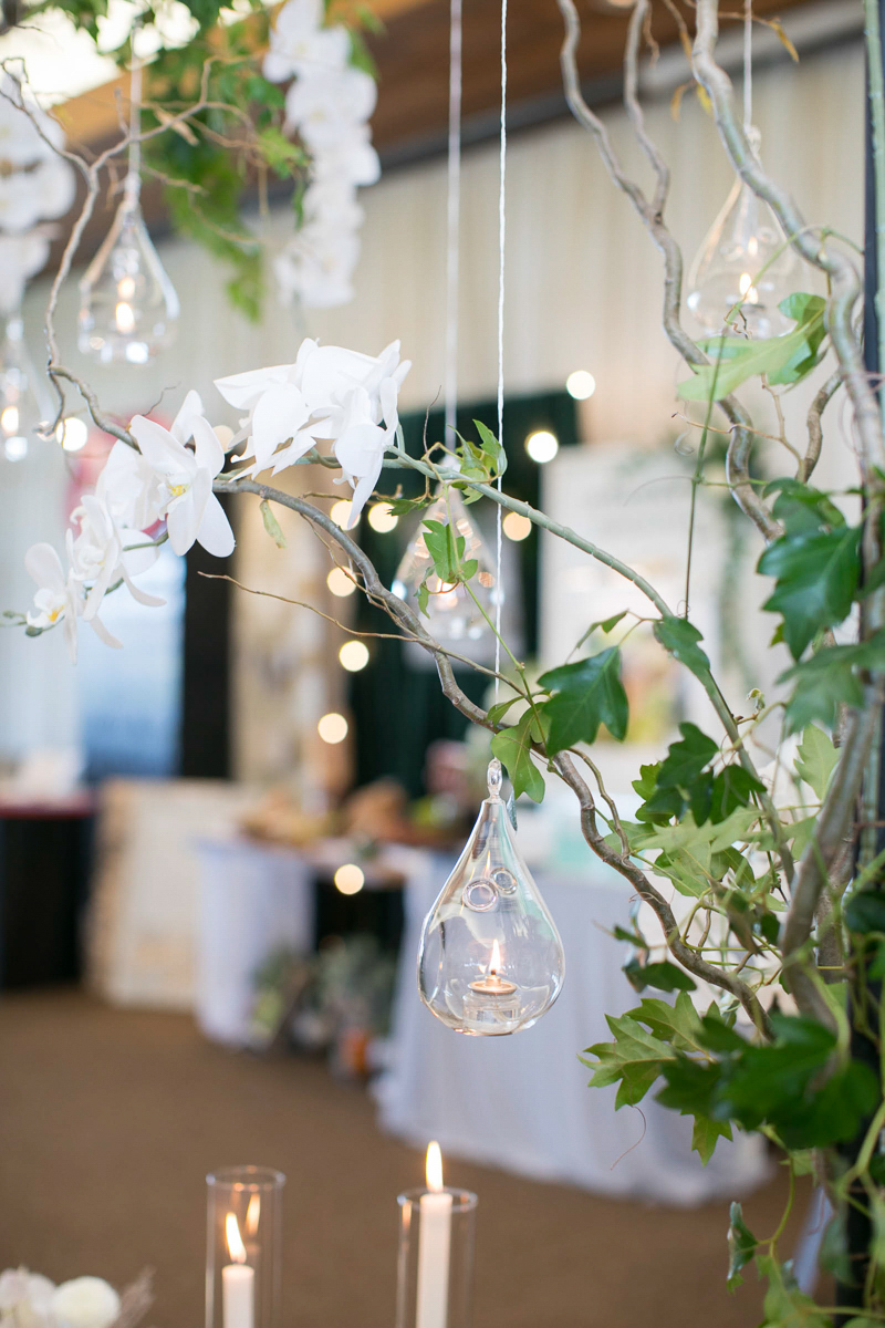 wedding day decor with hanging orchids