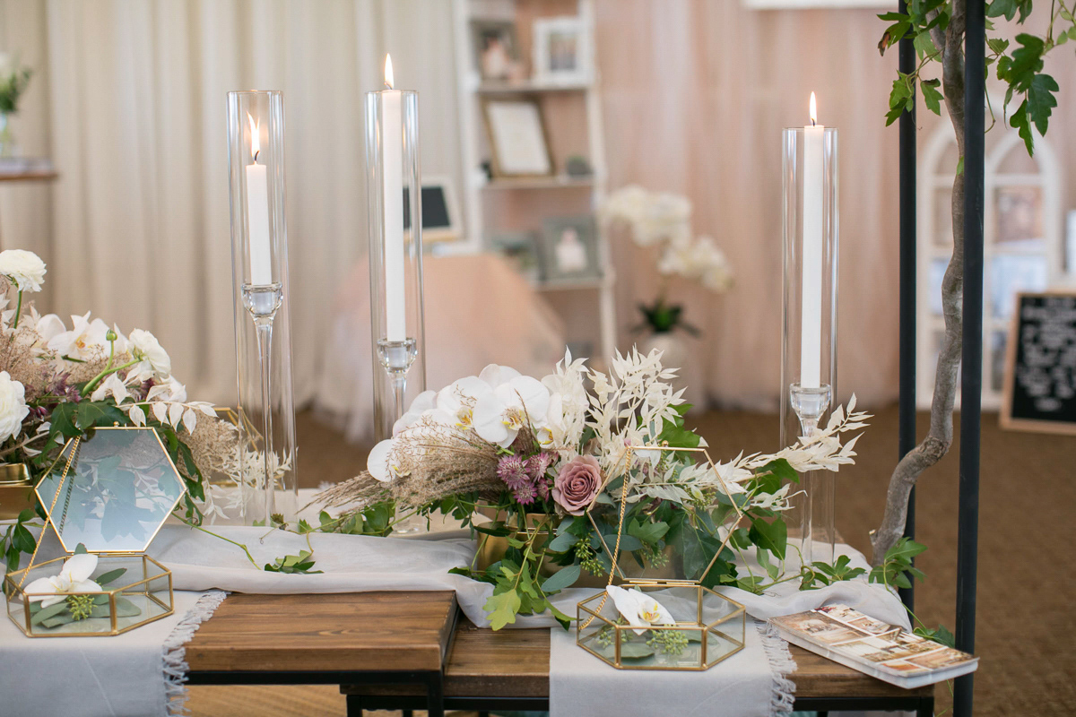 wedding tablescape and place settings with candles and florals