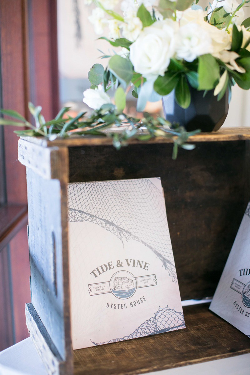 tide and vine menu with wooden crate and florals