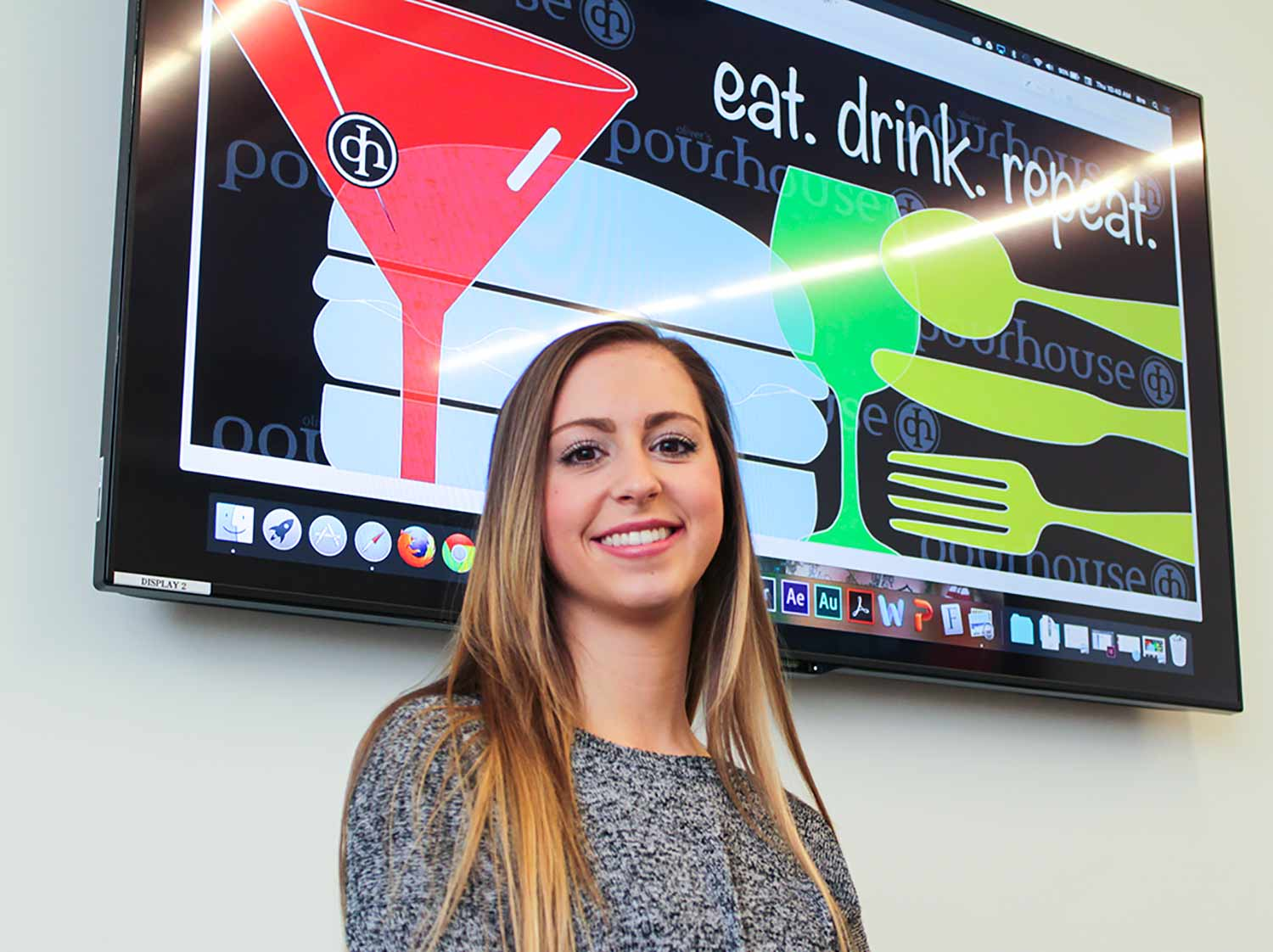 Breanna Kelly with her design which was chosen for Oliver's Pourhouse restaurant.