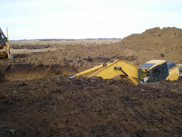 windmill backhoe in hole, barely visible.jpg