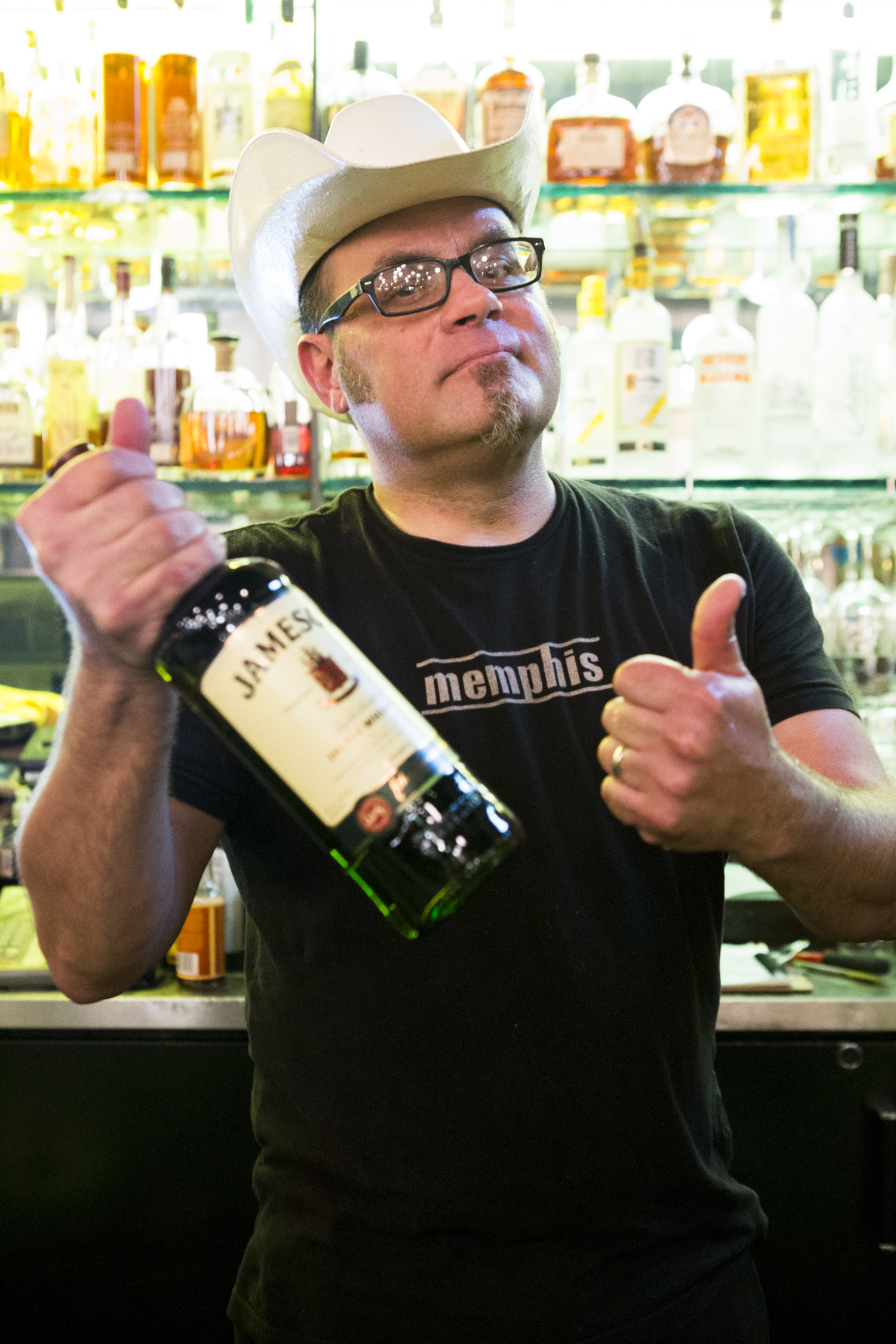 Dave Mau shows off his Whiskey bottle pose