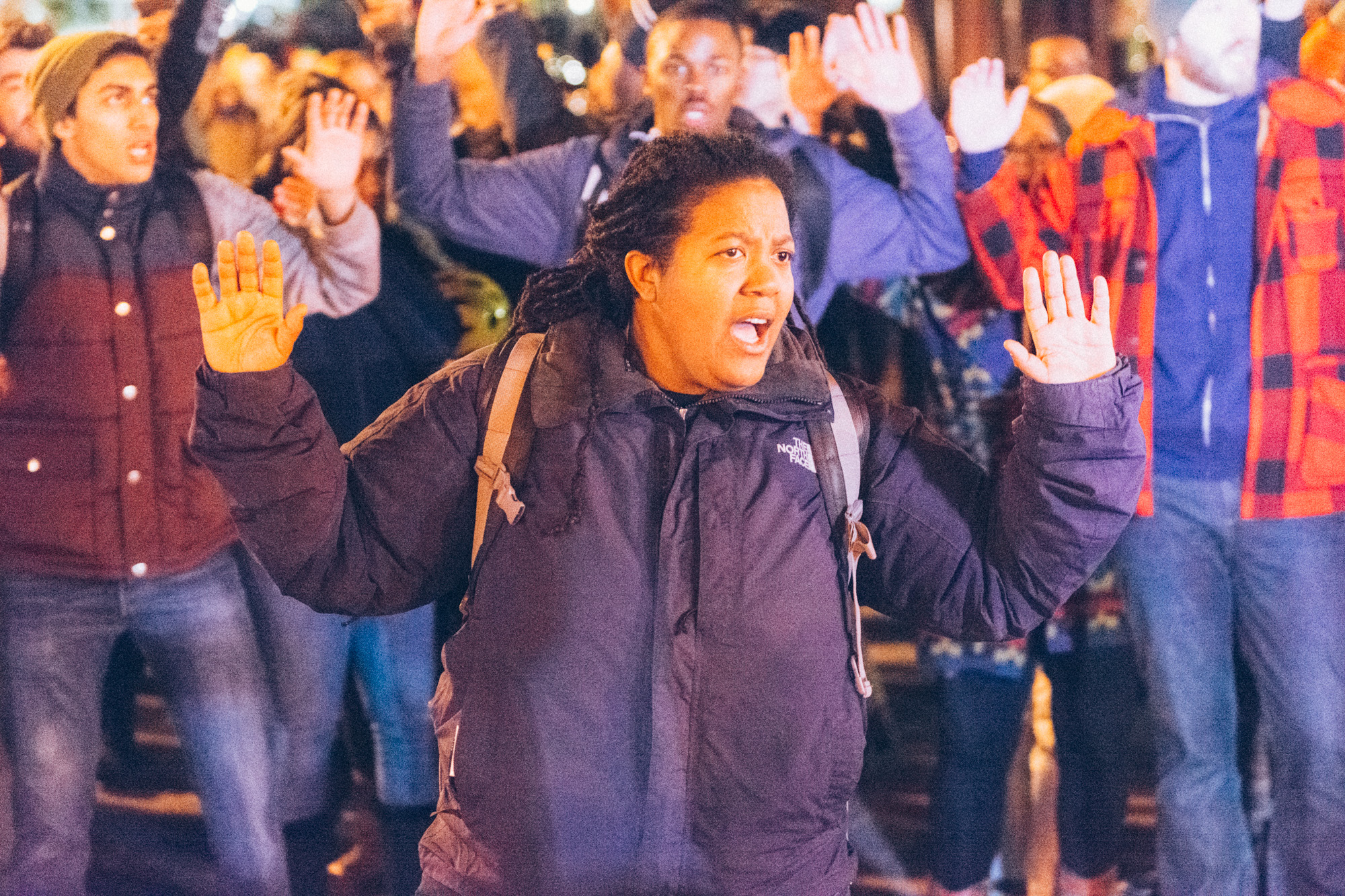 """The march stopped right before entering the intersection in the """"Hands-up, don't shoot"""" pose that has become iconic with this movement."""
