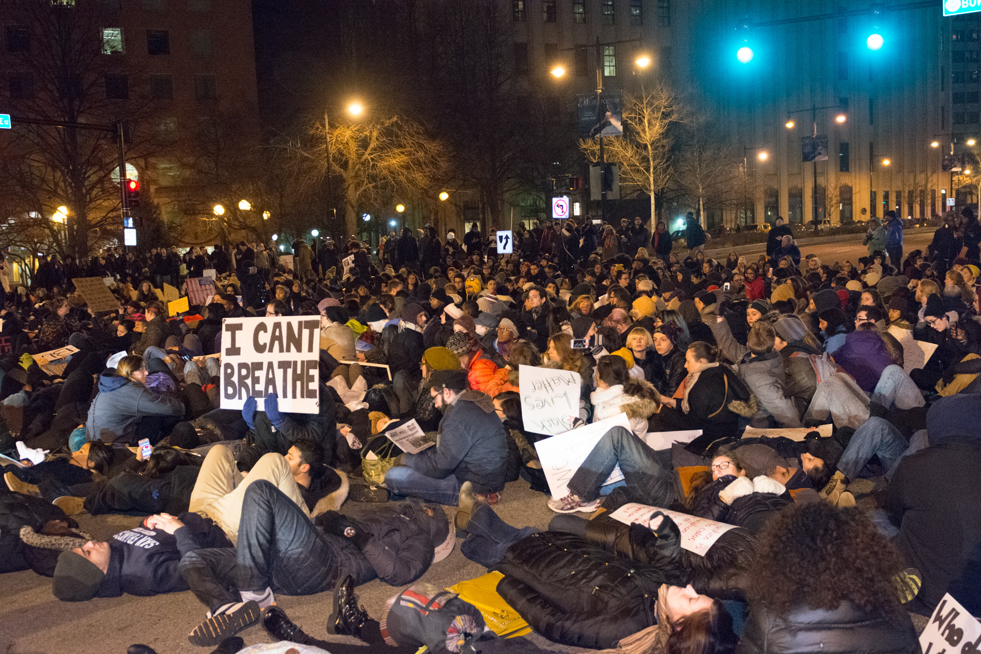 """The """"die-in"""" was supposed to last eleven minutes, one minute for each time Eric Garner cried out """"I can't breathe"""" before dying while to NYPD continued to choke him. An ambulance had to get through and within a few seconds the protesters cleared the streets and continued to march."""