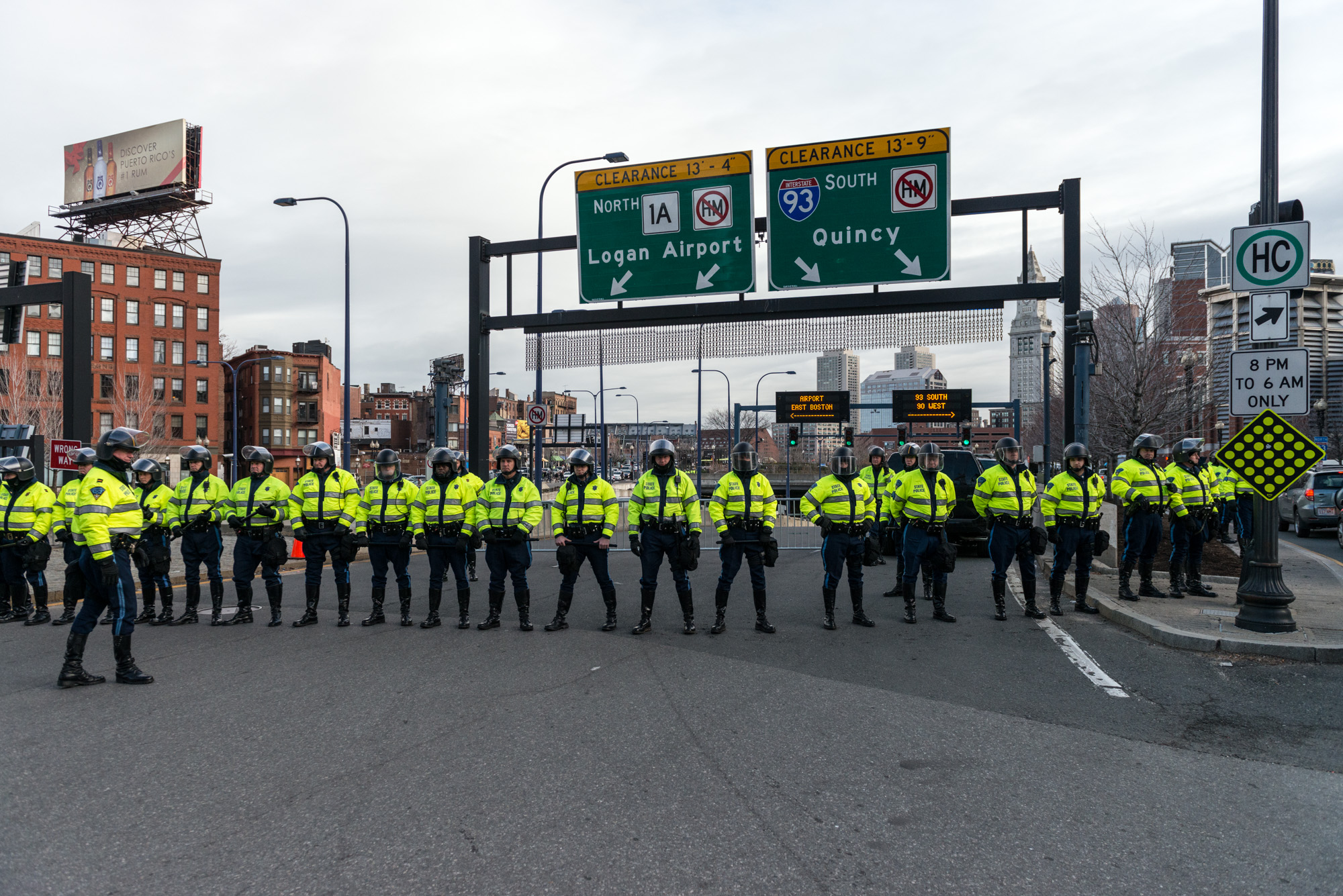 State Troopers with riot helmets blocking both directions of the I-93 connector ramp