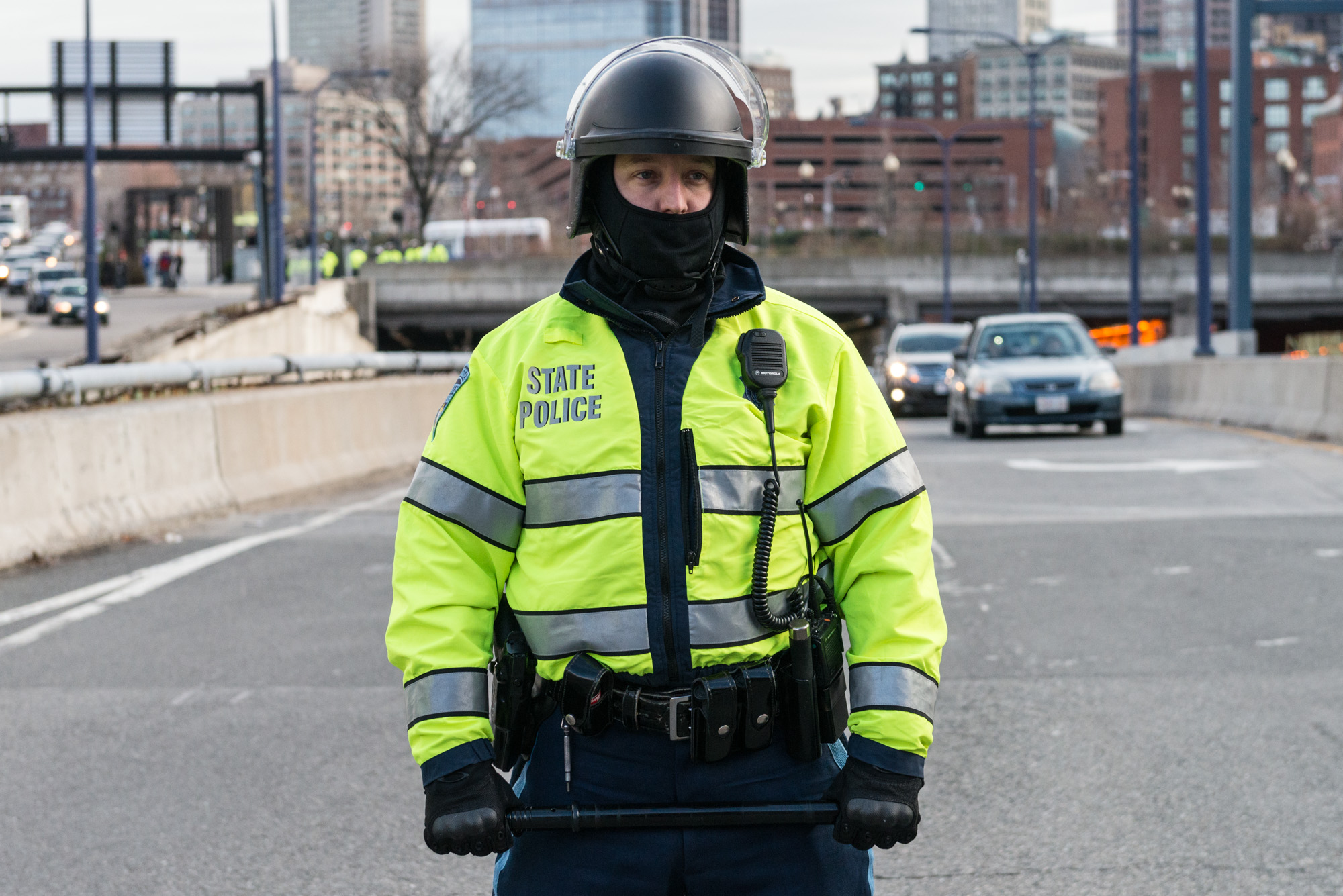 State Trooper with baton in hand blocking the roadway