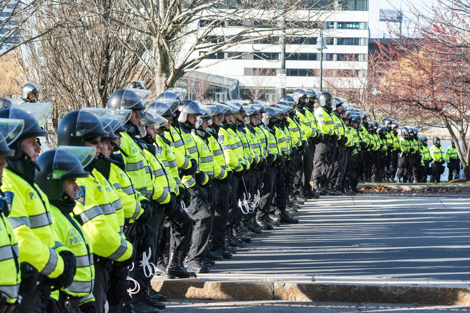 A line of police officers blocked both sides of the street and the adjacent park