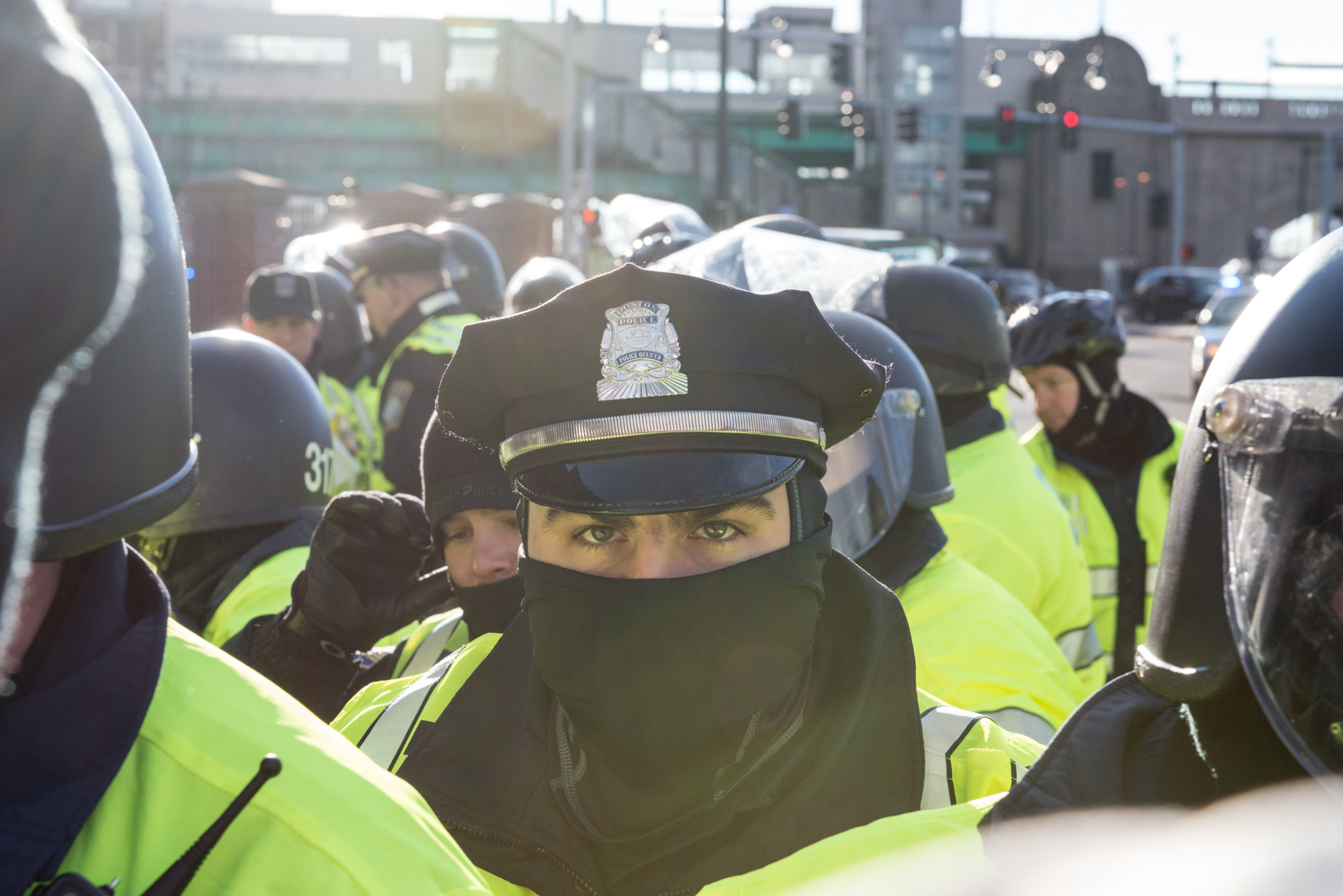 Behind the line of helmeted officers were dozens more in the street