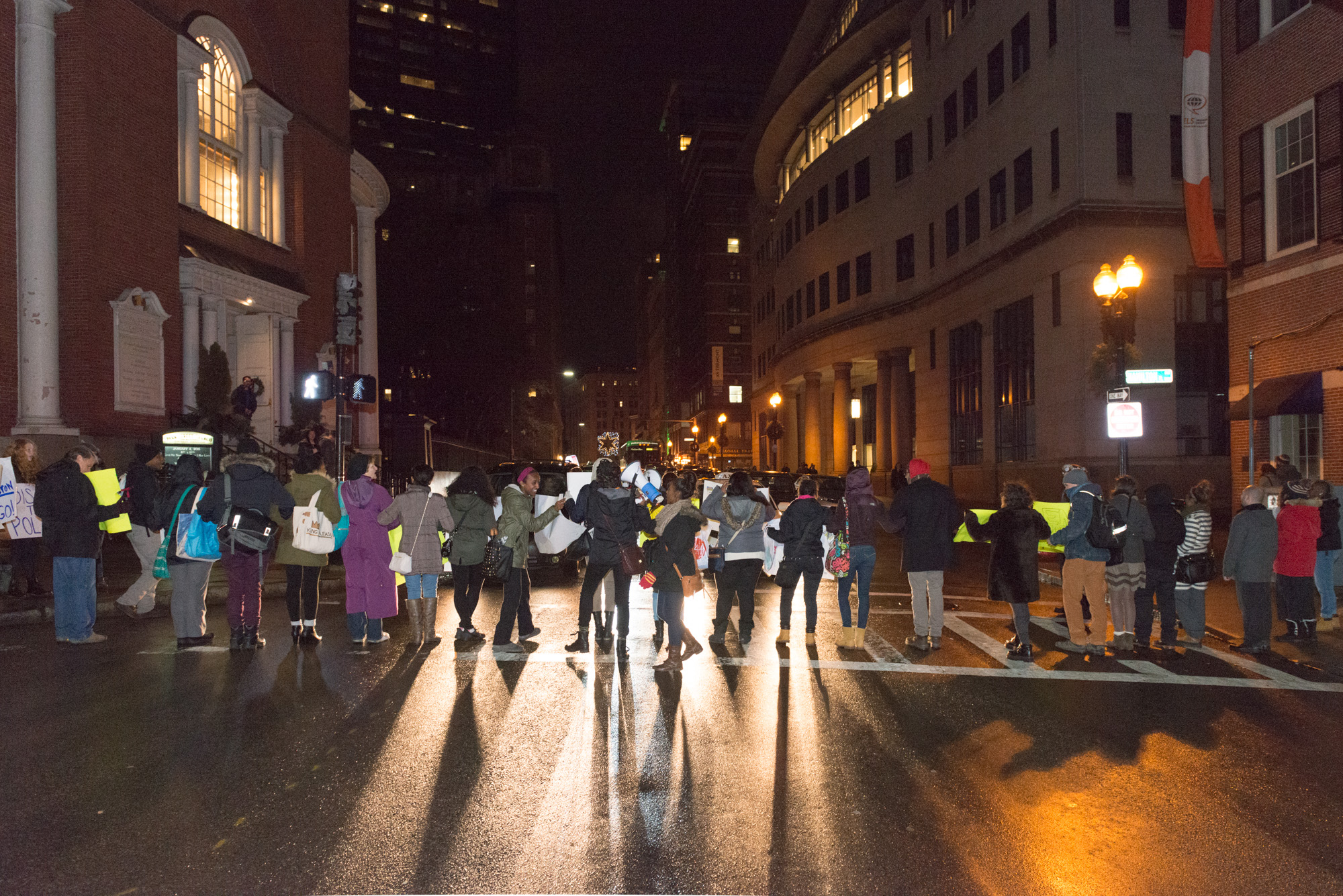 Protesters in a line blocking traffic on Tremont St.