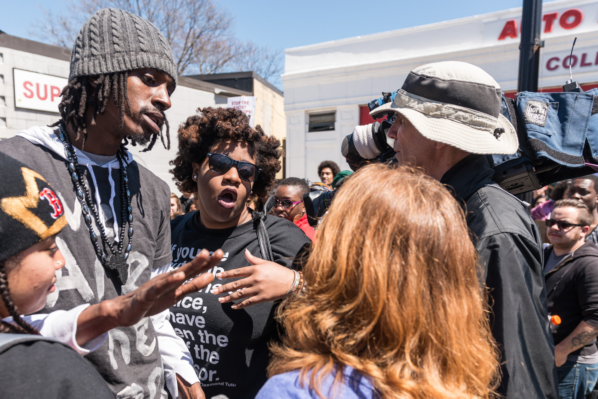Two of the organizers confronting local media