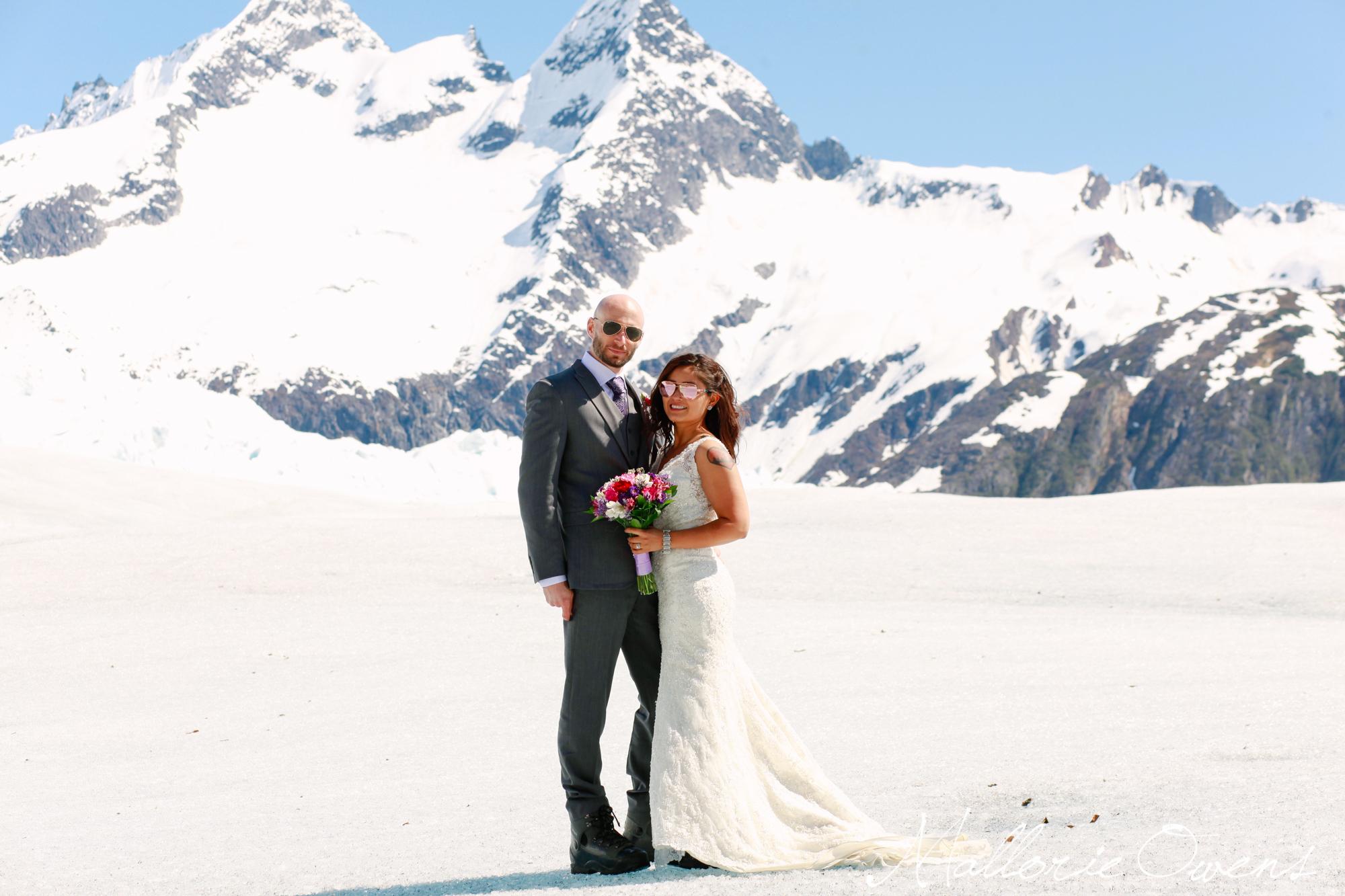 Bride and Groom on Mendenhall Glacier in Juneau, Alaska | MALLORIE OWENS