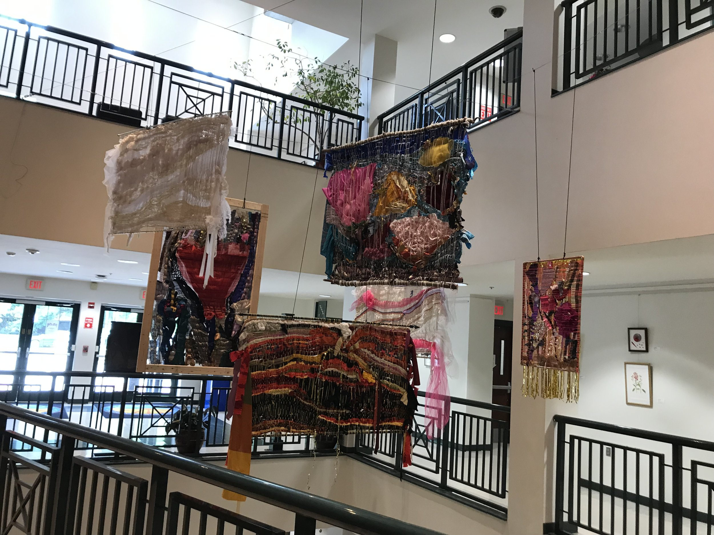Janel's weavings hanging at the Pedals and Stems group art show at the Takoma Park Community Center May 16th, 2019
