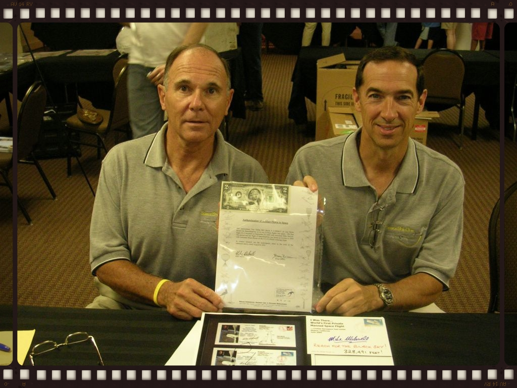 Melvill and Binnie hold the flown $2 bill with its flown flight certification letter in San Diego California.