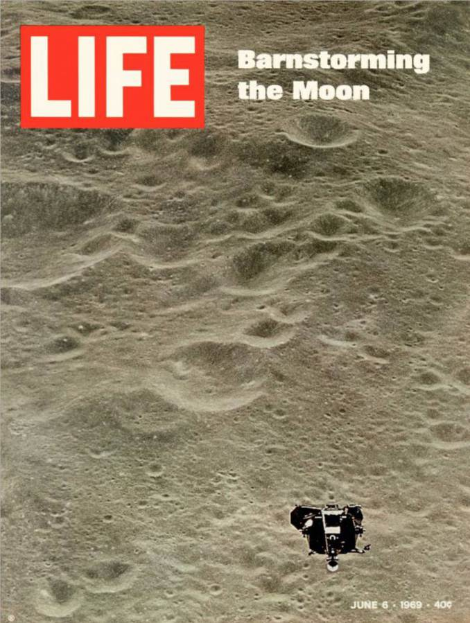 June 1969 cover scan of Life Magazine, showing the image of the Apollo 10 lunar module in flight above the lunar surface as part of the last test flight before the historic landing of Apollo 11 the following month. On board with Gene Cernan is the flown $2 bill.
