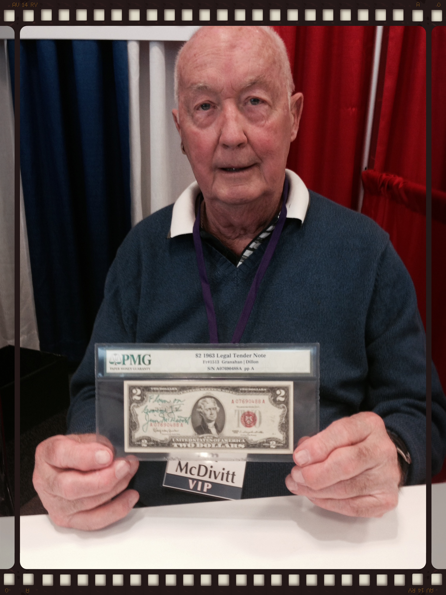 Jim McDivitt reunited with his flown $2 bill at SpaceFest in Pasadena, California, in May of 2014.
