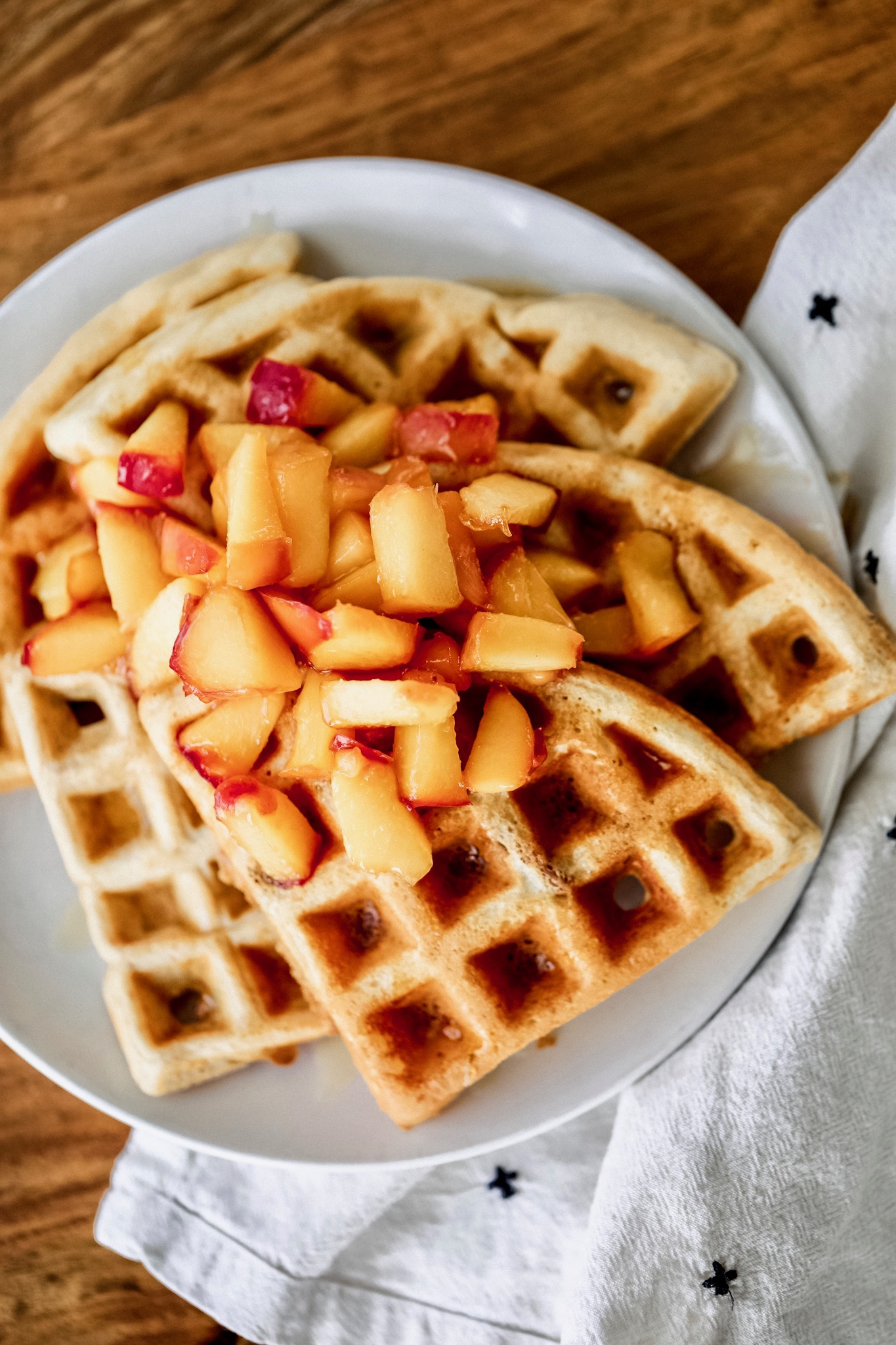 Cinnamon Pecan Waffles with caramelized peaches - Make 4 servings355 calories / 9.5F / 45.5C / 22 P