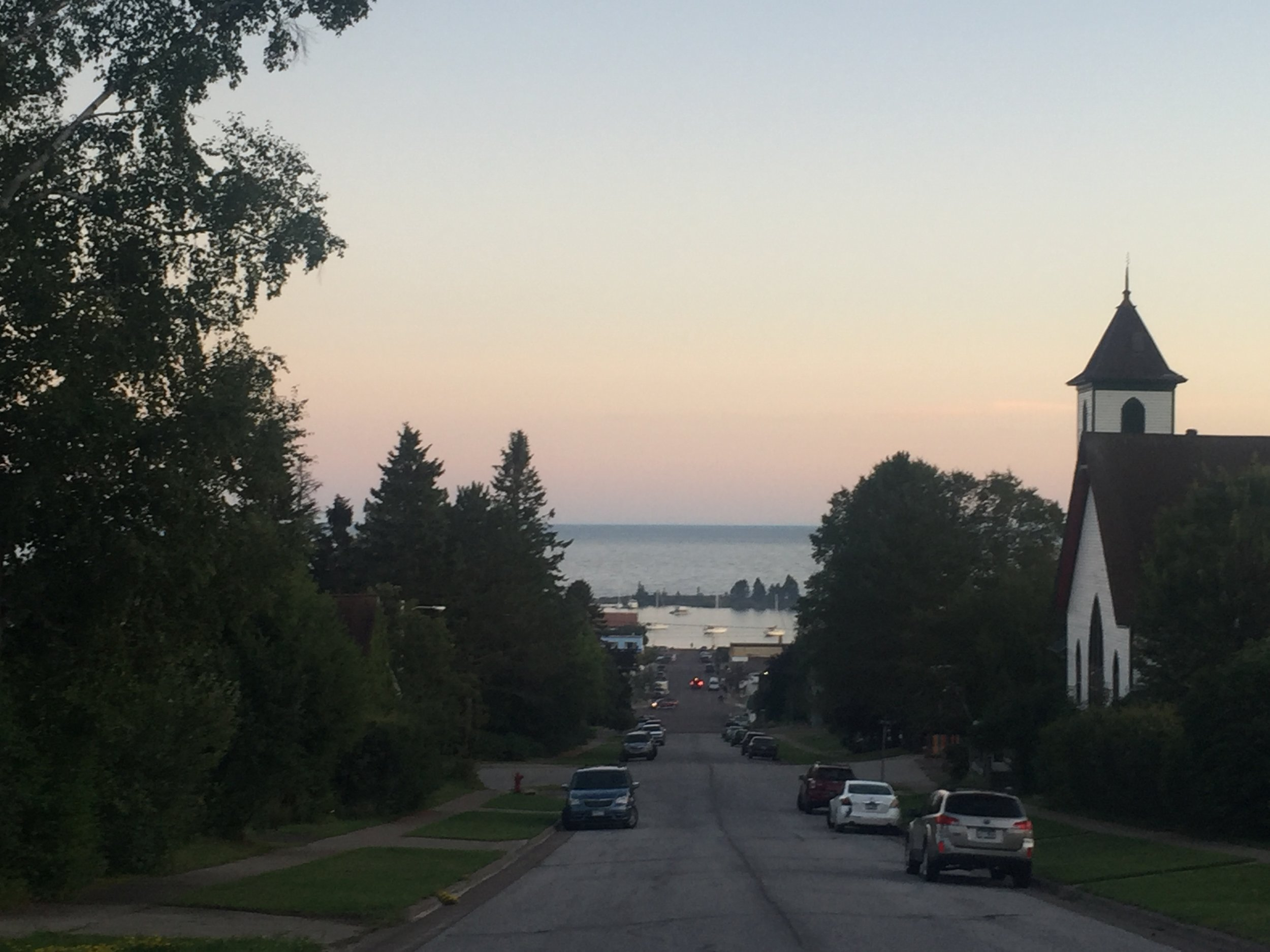 Plein Air painters often settle their easels into the boulevard out front to capture this iconic Grand Marais view. A brief 4 block walk gets you into downtown Grand Marais and all it's comforts. One block the other way and you're at the school and YMCA.