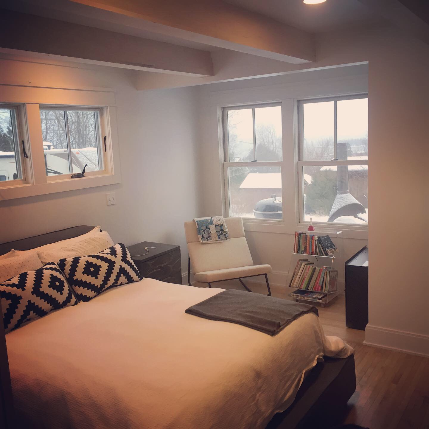 The master bedroom features his and hers closets, and a sunny alcove for sitting and overlooking the big lake. Floors are refinished birdseye maple from 1935 and maple beams help add interest and stlye to the ceiling.