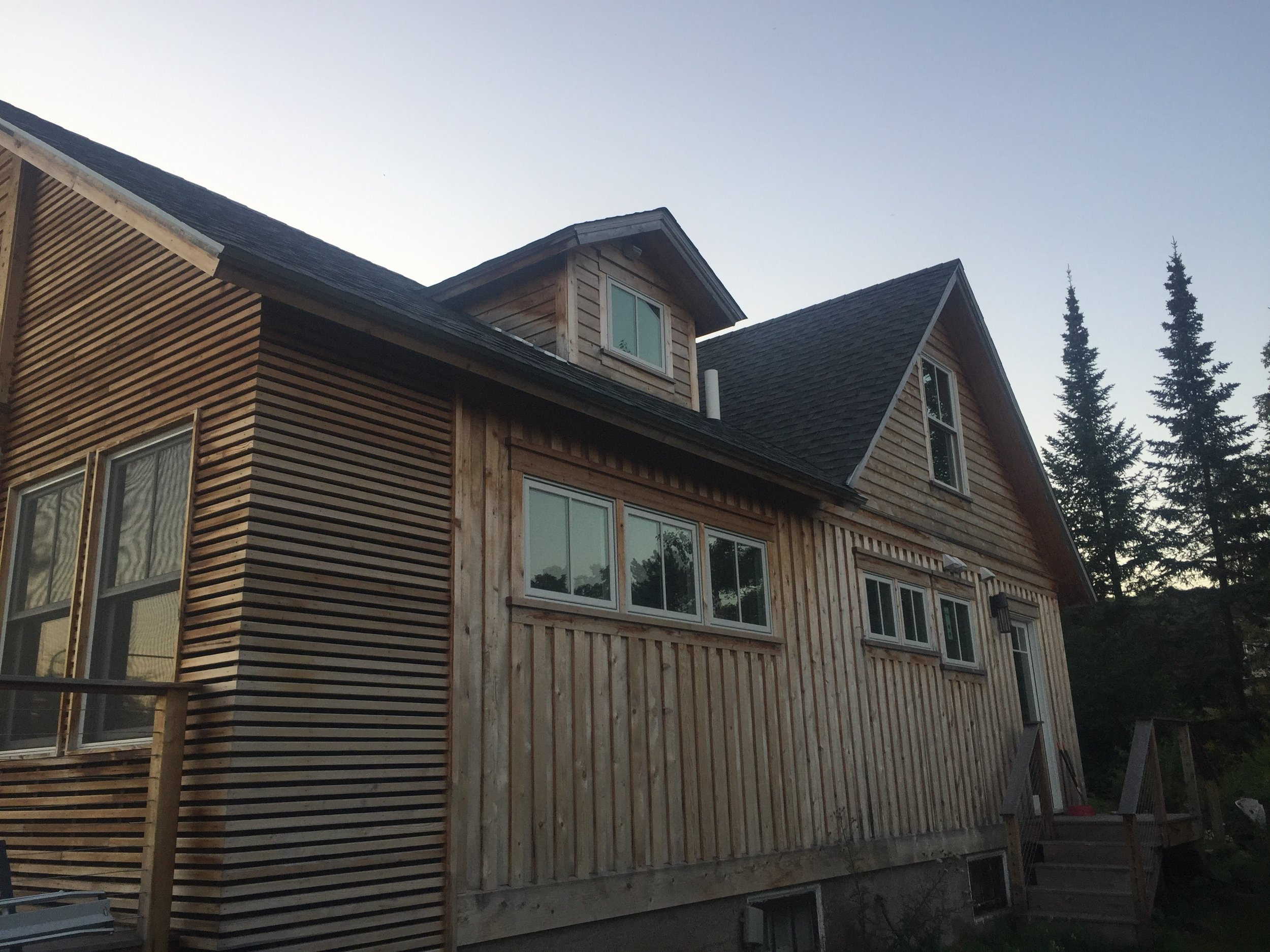 The rear of the house has a yard, sauna, and workshop. Plenty of room for a garden, garage, chickens, you name it!