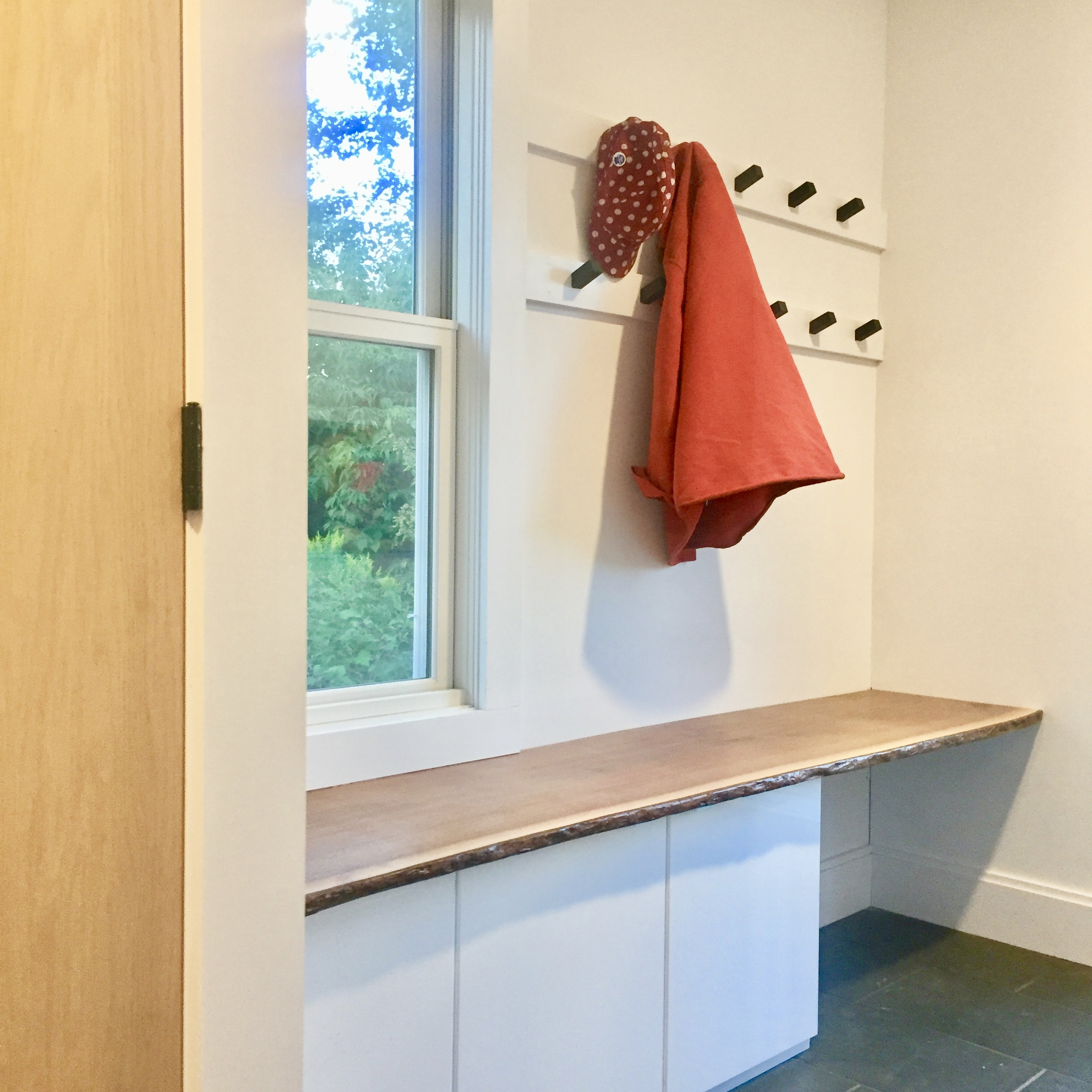 Who doesn't like a mudroom? And live-edge walnut? Storage and containing the mess was the name of the game here. The mudroom/laundry has brand new LG Steam washer and dryer, a counter for folding laundry, and closets, cubbies and hooks for all of your outdoor gear.