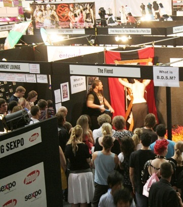 The Fiend performing at his BDSM education booth at Brisbane Sexpo.
