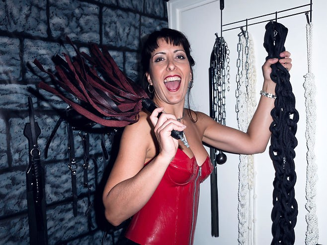 Lots of equipment: To work as a professional domina, you need a lot of equipment. Here Mistress Kalyss Mercury shows different whips that can be used in a session. Photo:KRISTER SØRBØ