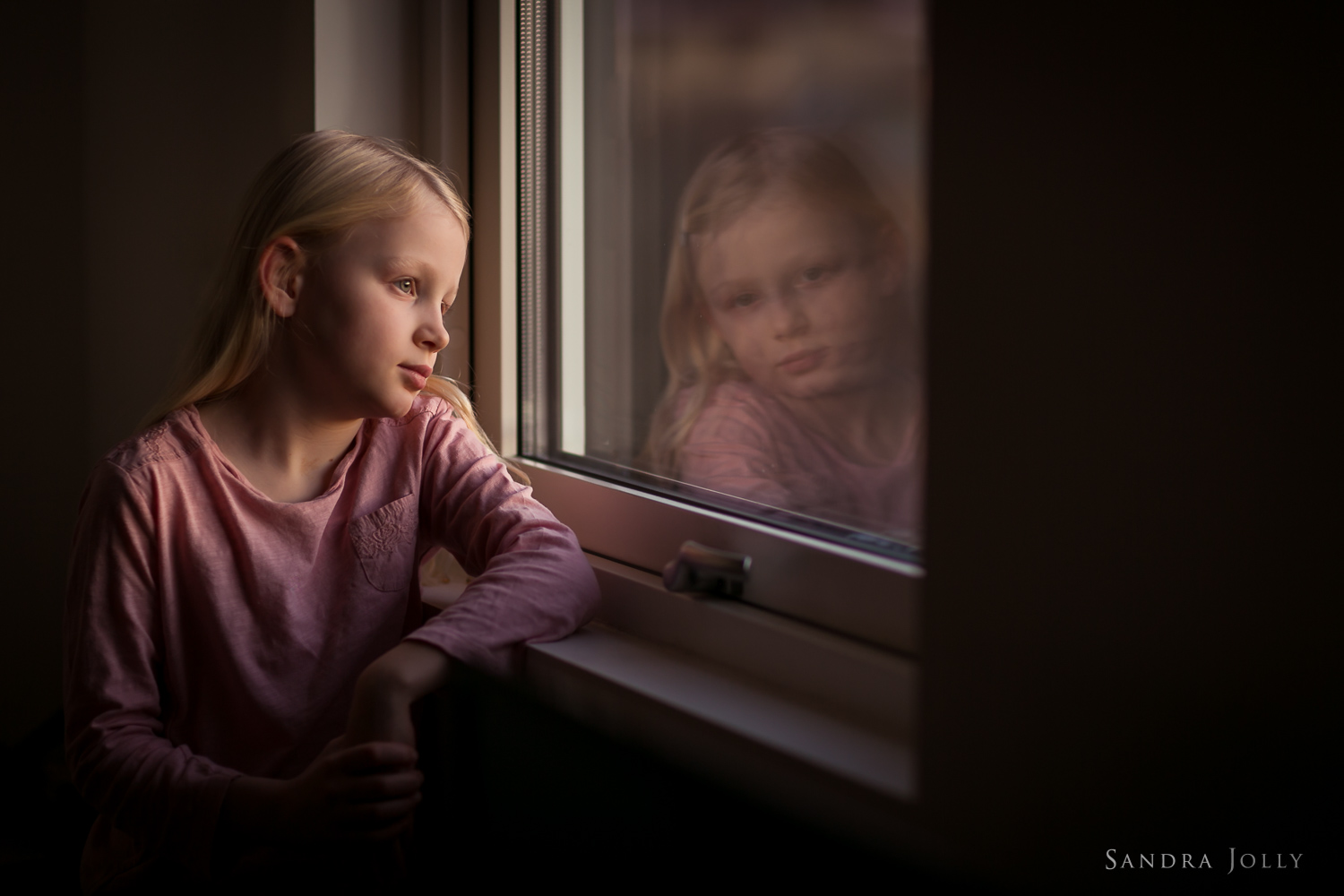 Photo-of-a-girl-and-her-window-reflection-by-Sandra-Jolly.jpg