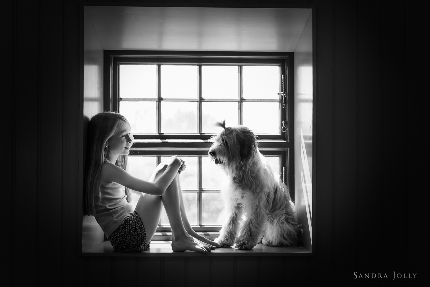 Girl-and-her-dog-by-Stockholm-lifestyle-photographer-Sandra-Jolly.jpg