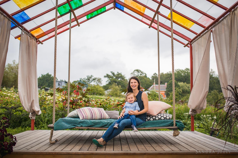 mom-and-daughter-on-swing-in-ulriksdals-slott-trädgård-by-Sandra-Jolly.jpg