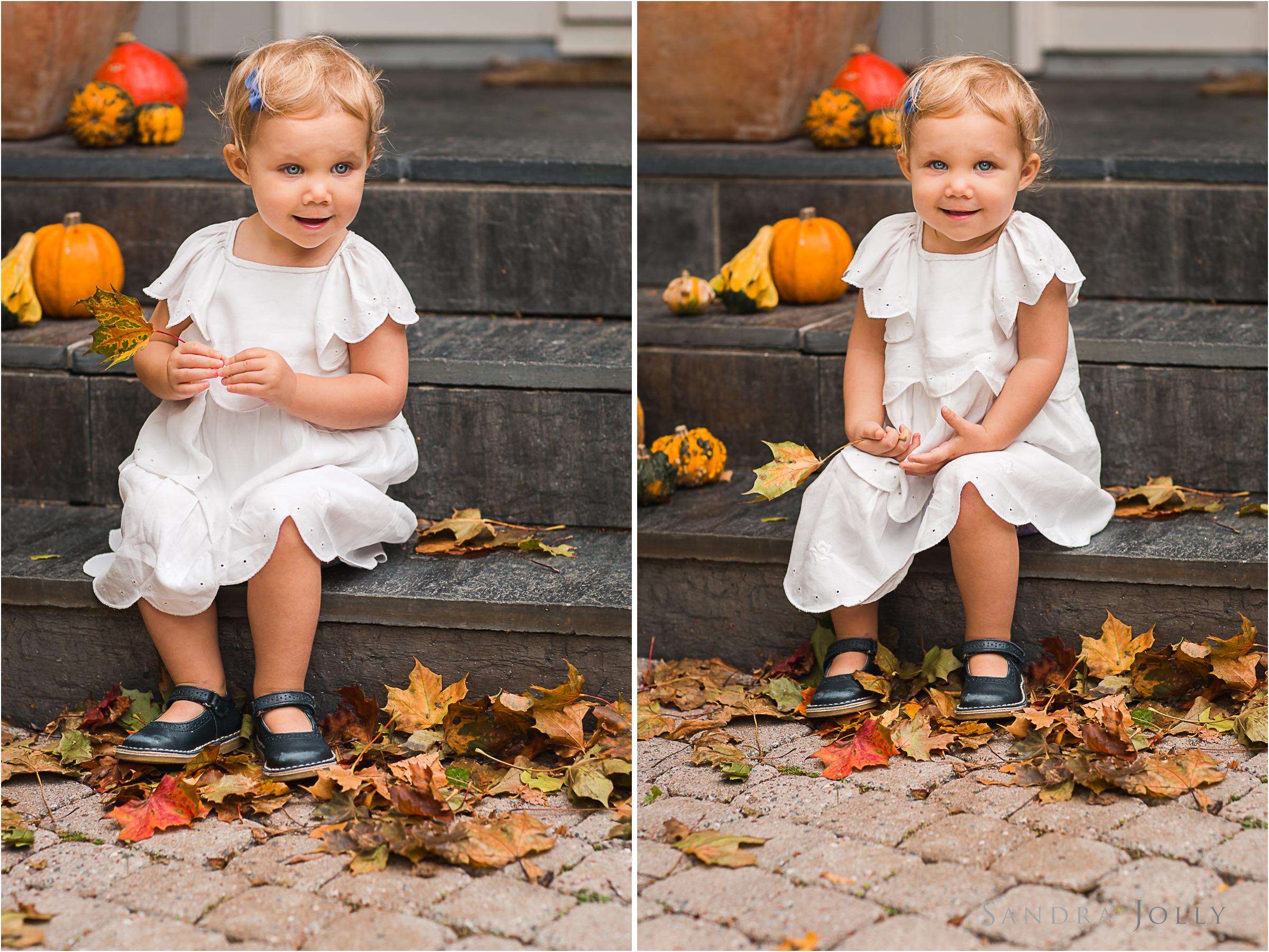 autumn-portrait-of-girl-with-pumpkins-by-child-photographer-sandra-jolly.jpg