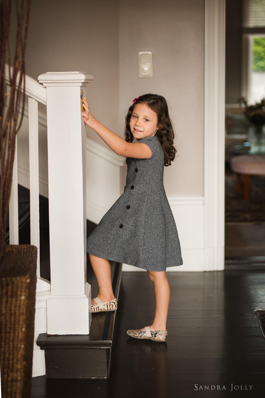 portrait-of-girl-on-stairs-by-barnfotograf-Sandra-jolly.jpg