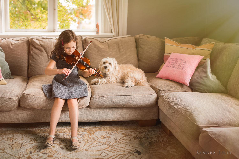 portrait-of-girl-playing-violin-beside-pet-dog-by-child-photographer-Sandra-jolly.jpg