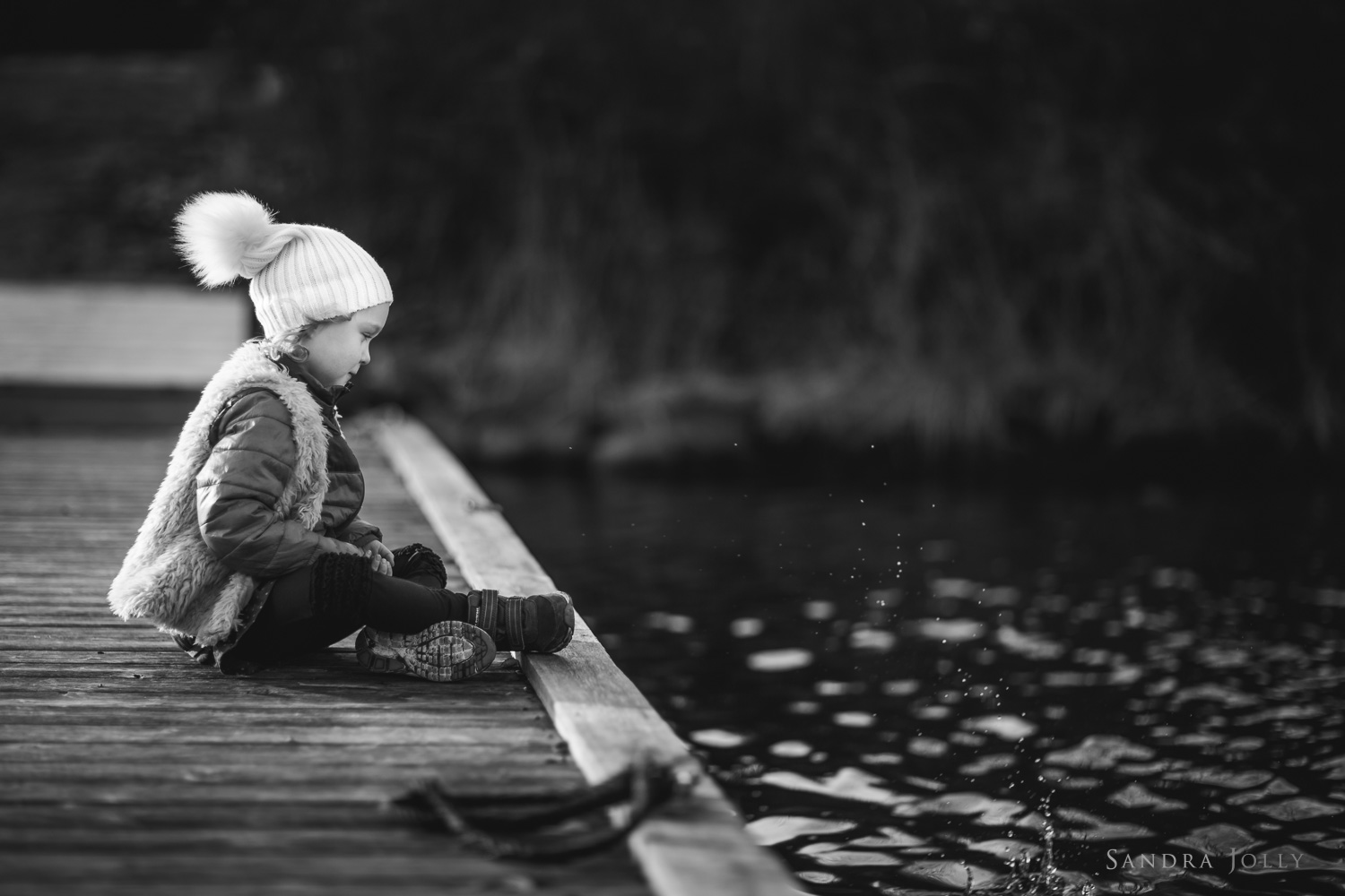 black-and-white-portrait-of-girl-by-water-by-barnfotograf-Sandra-Jolly.jpg