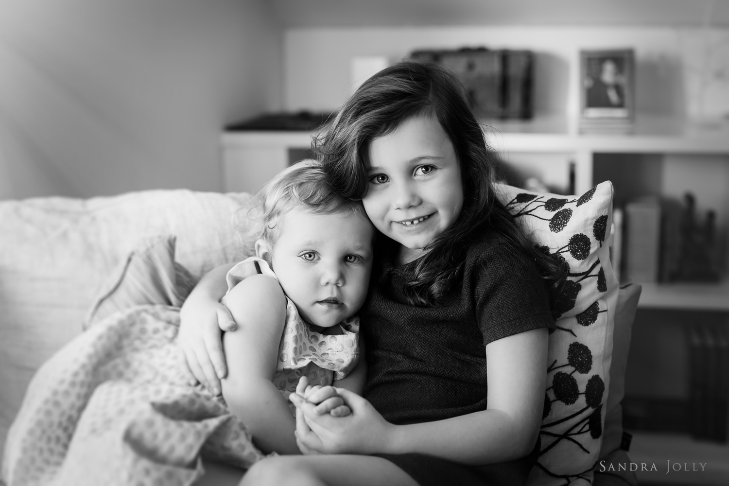portrait-of-young-sisters-together-by-family-photographer-sandra-jolly.jpg