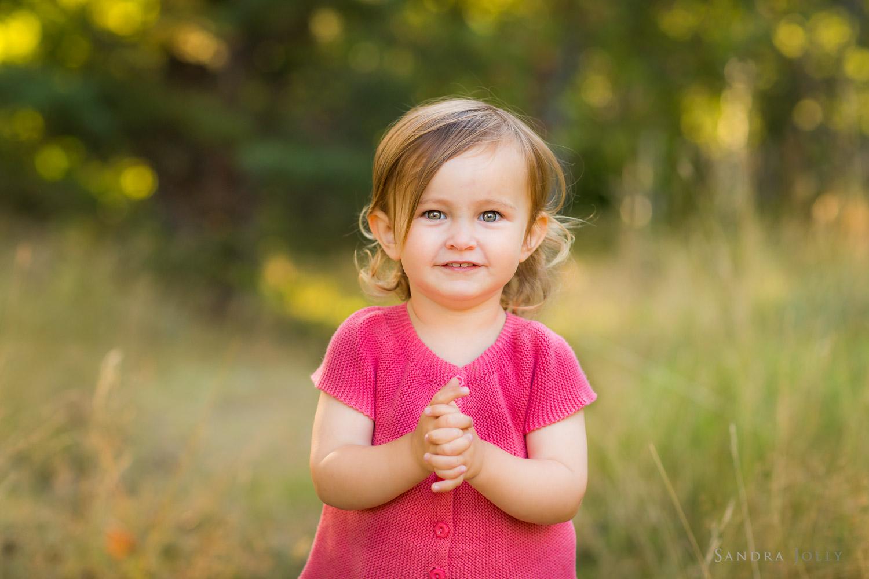 Portrait-of-a-happy-little-girl-by-Danderyd-child-photographer-Sandra-Jolly.jpg