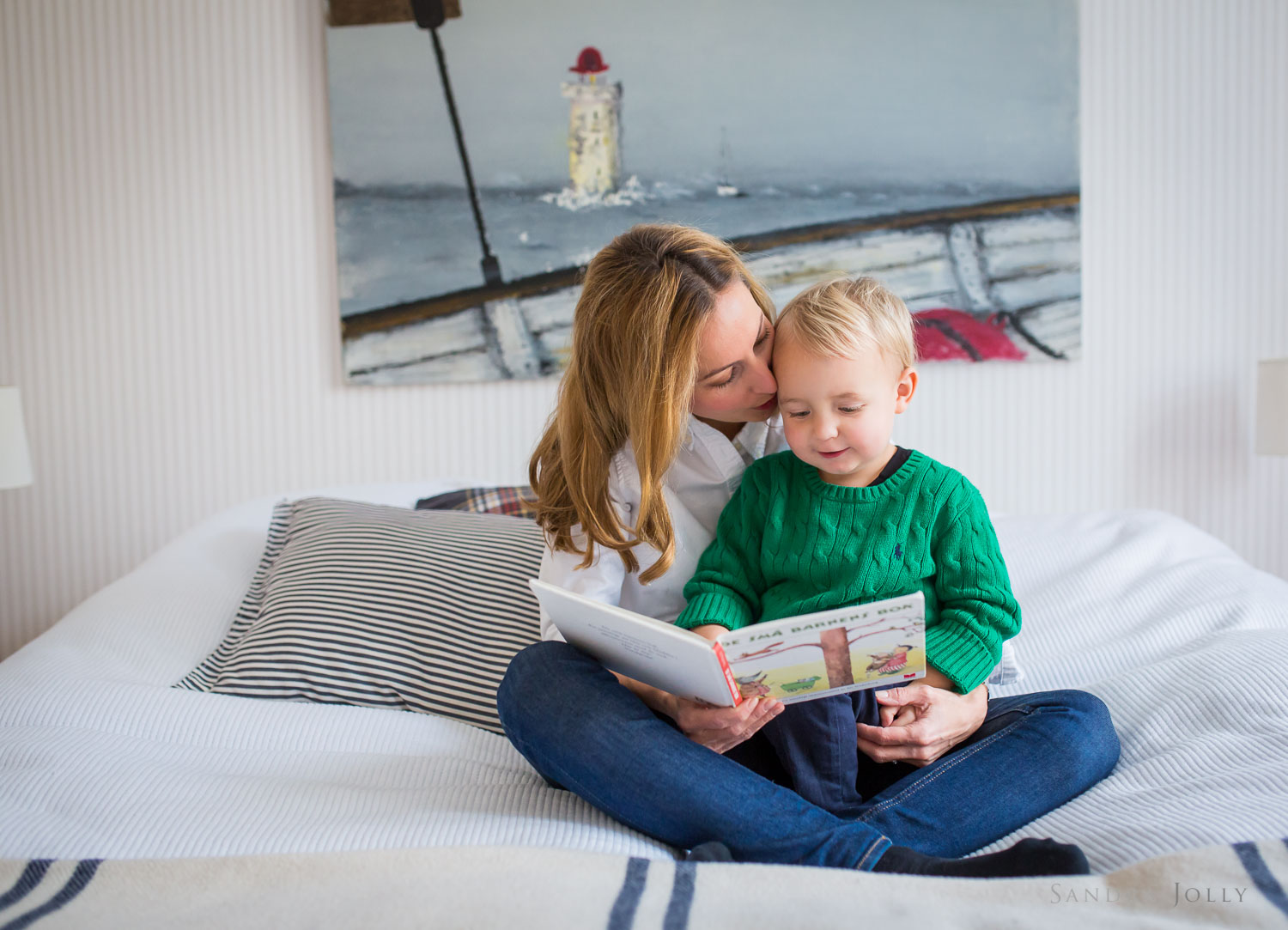 mother-and-son-reading-on-bed-by-Stockholm's-best-family-photographer-Sandra-Jolly.jpg