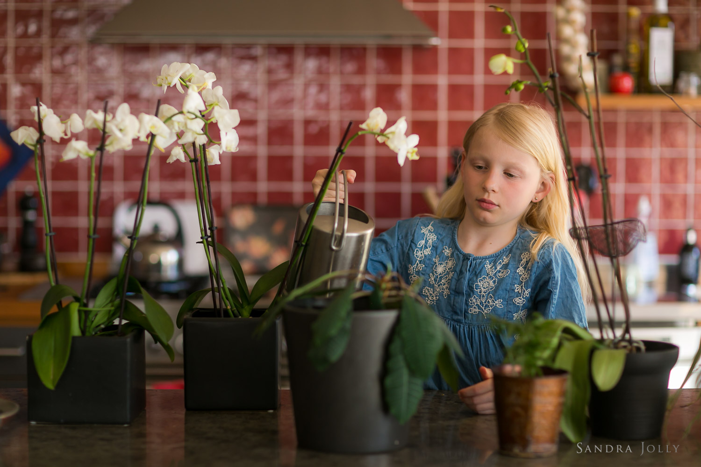 photo-of-girl-watering-flowers.jpg