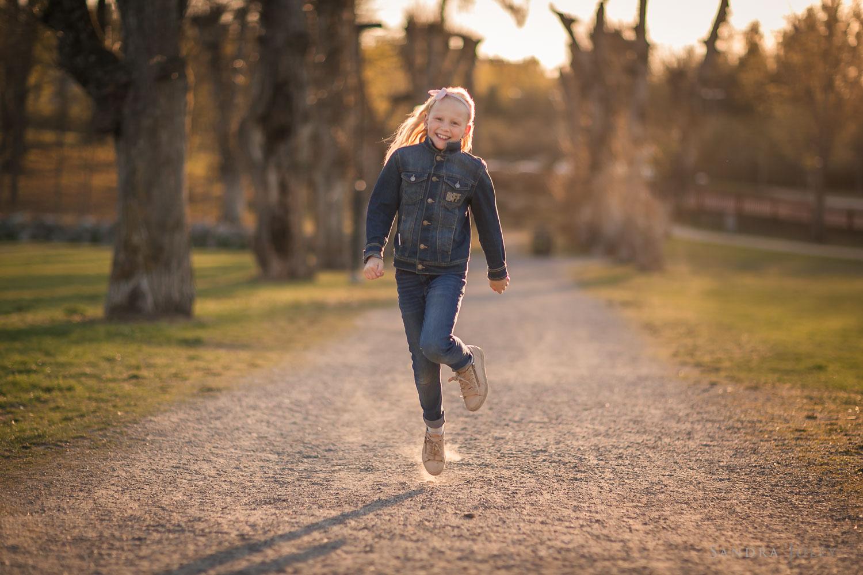 beautiful-girl-skipping-by-child-photographer-sandra-jolly.jpg