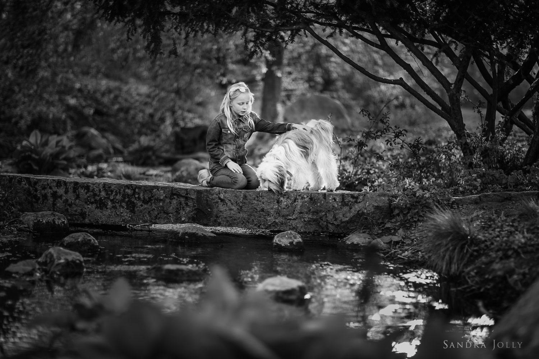 girl-and-dog-on-bridge-by-stockholm-child-photographer-sandra-jolly.jpg