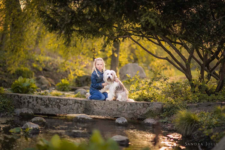girl-and-dog-on-bridge-by-stockholm-family-photographer-sandra-jolly.jpg