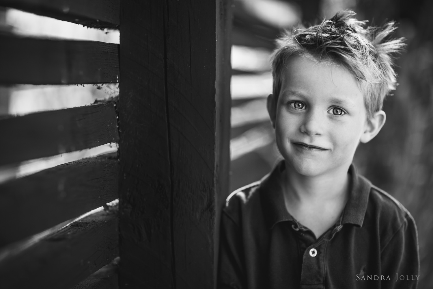 black-and-white-photo-of-a-boy-by-barnfotograf-sandra-jolly.jpg