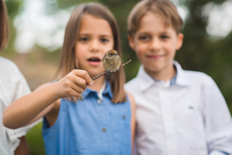 girl-with-bird-by-stockholm's-best-family-photographer-sandra-jolly.jpg