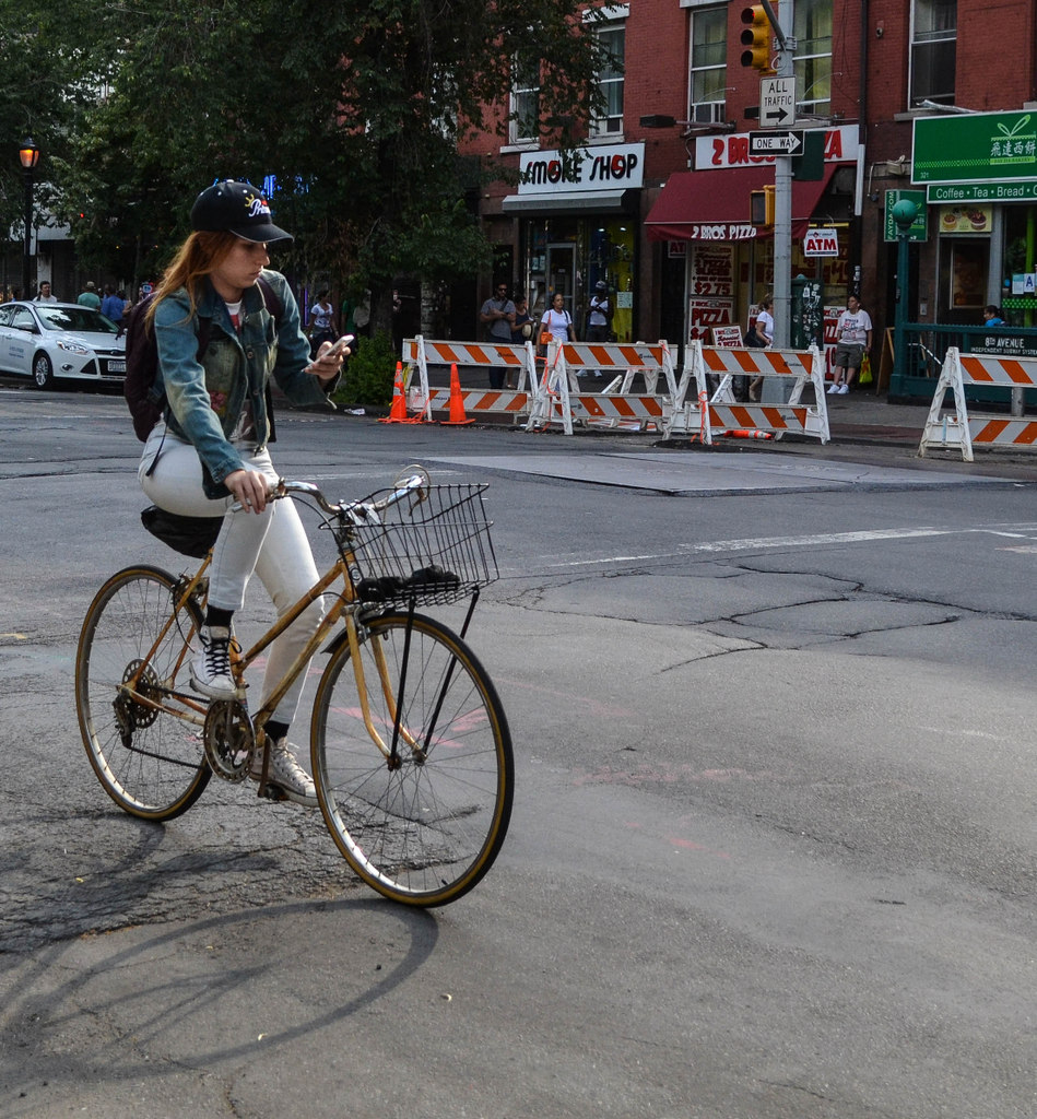 Texting while biking on Sixth Avenue: Badass! or Nuts?
