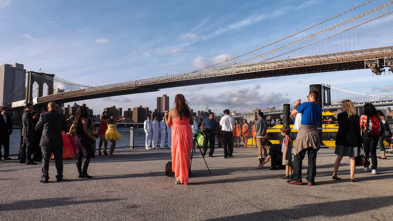 The wedding party draws the attention of tourists and locals