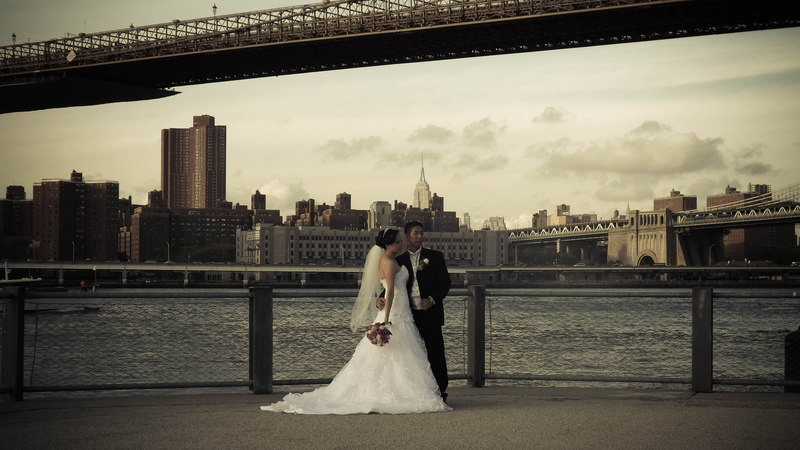 Striking a pose with the Brooklyn Bridge, Manhattan Bridge and Empire State Building in the frame