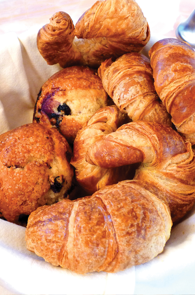 Fresh croissants and breakfast muffins