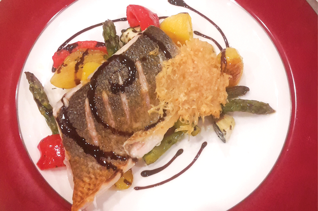 Pan seared seabass with roasted vegetables and a balsamic reduction