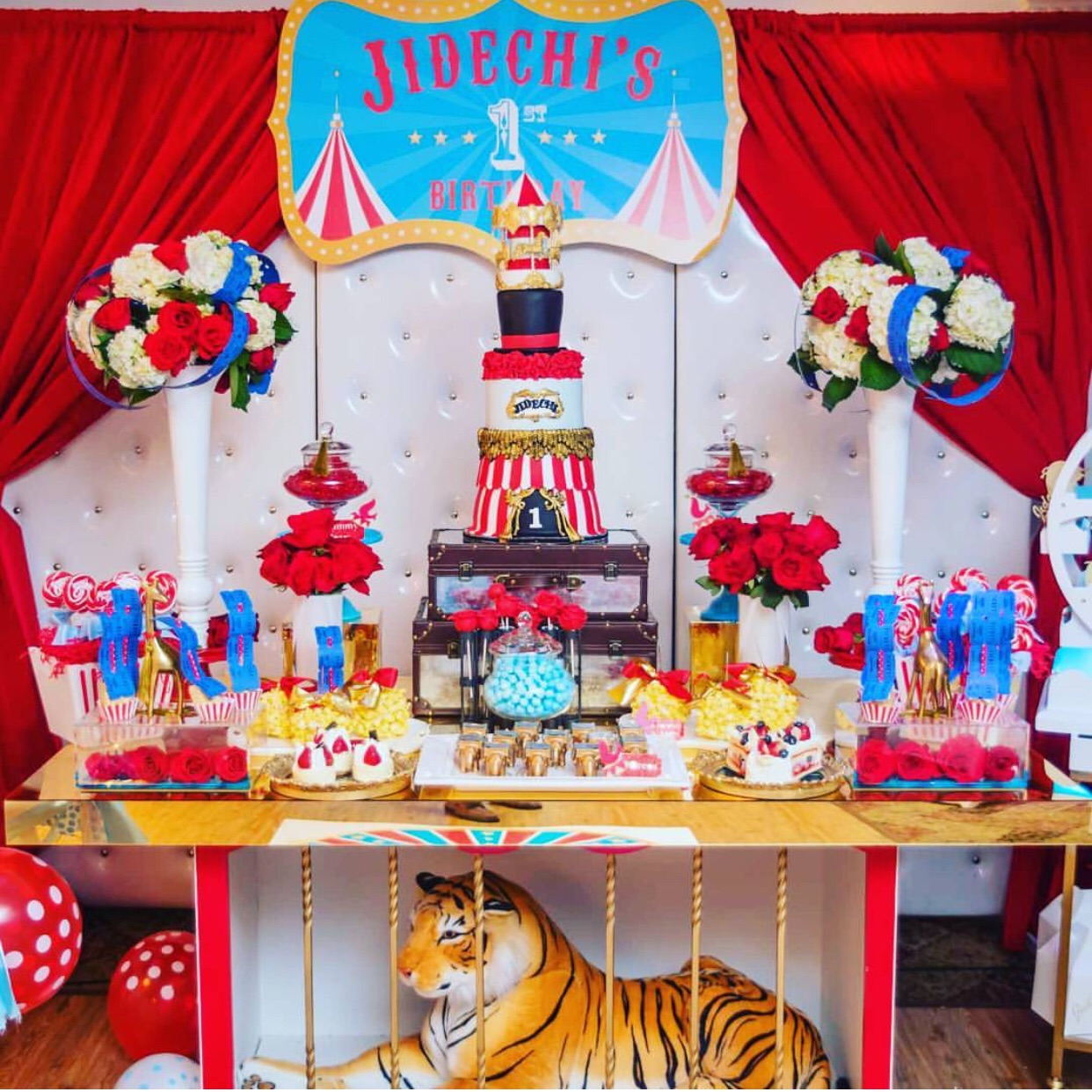 The dessert buffet complete with a tiger in a cage.