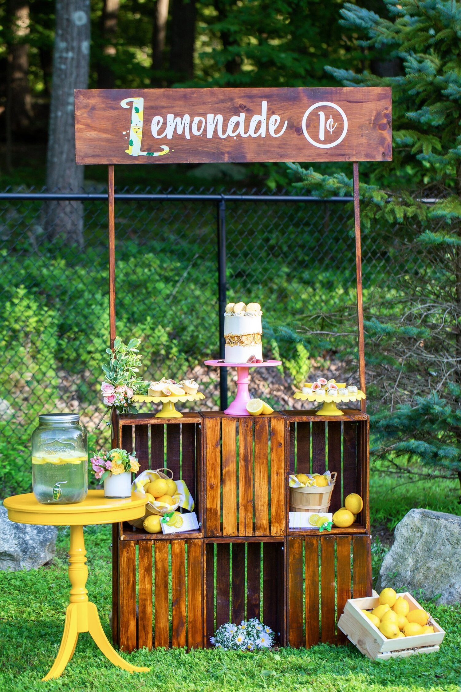 Yosi of Favors And More designed and built this wooden lemonade stand that was the perfect complement to our theme. The lemon yellow end table was from Claudia of Tie A Bow Rentals.