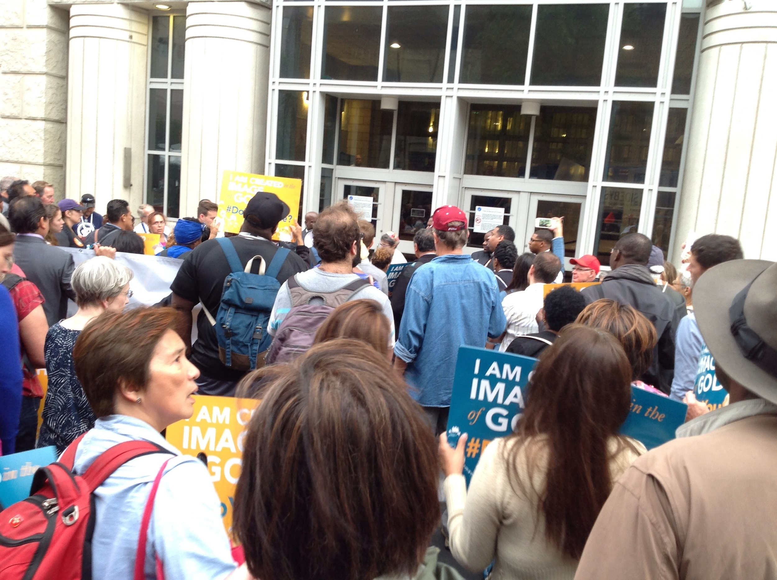 """Second stop along our march where individuals inside the federal detention building were awaiting deportation, saw and heard us chanting """"Do you see me?"""" and responded by tapping on the windows, at which we responded - """"We see you!"""" """"We see you!""""   Powerful!"""
